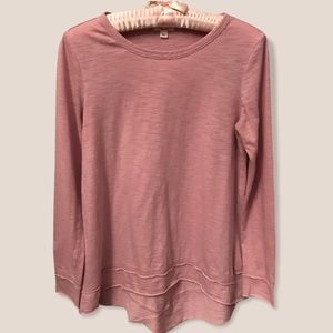 Dylan pink long sleeve raw seam high low top